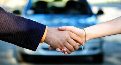 shake hands on a car background